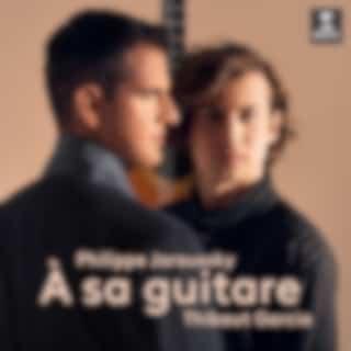À sa guitare